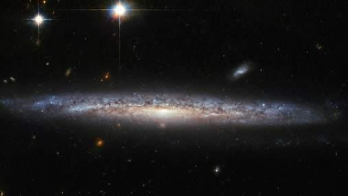 """Телескоп """"Хаббл"""" обнаружил вещество, которое замедляет звездообразование в галактиках"""